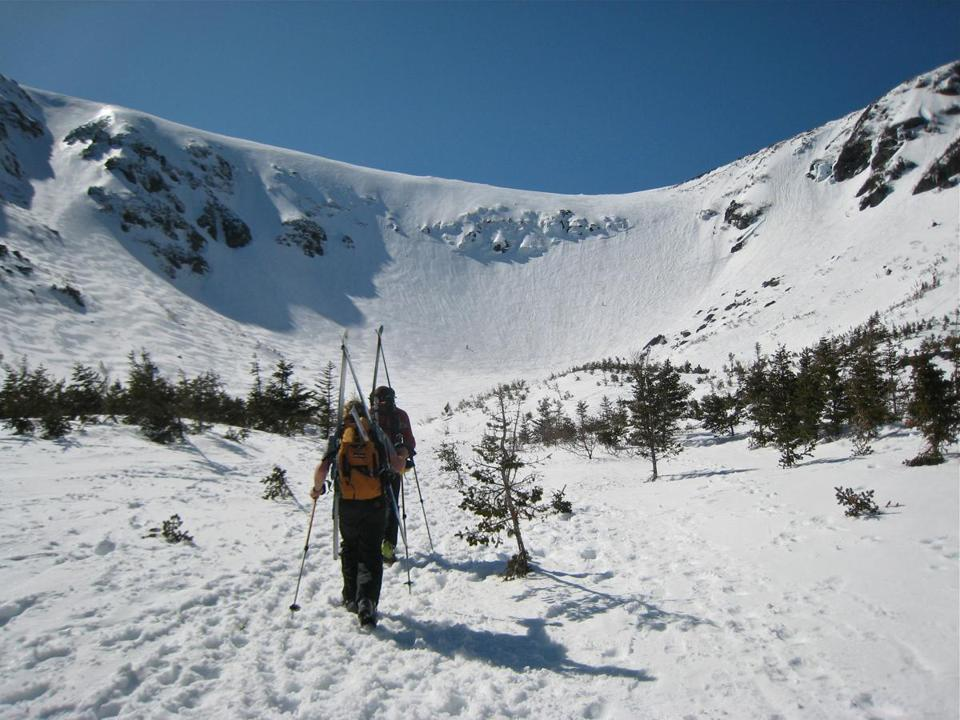In New Hampshire, Tuckerman Ravine is a large glacial cirque on the southeast shoulder of Mount Washington that fills with snow from the mountain's summit. Only expert downhill and telemark skiers should attempt it, but spectators thrill at watching them.