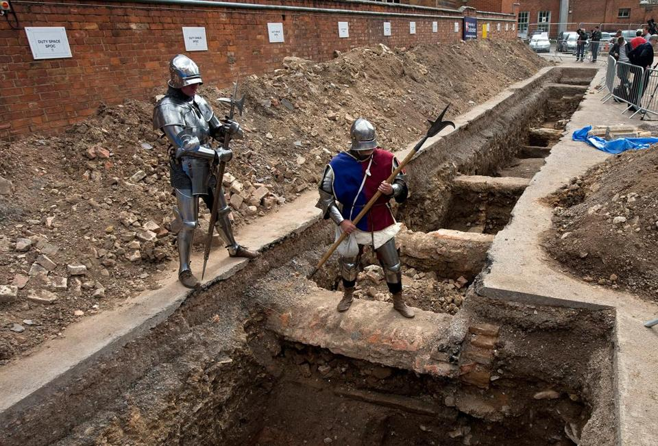 Men dressed as knights posed at the site where a skeleton believed to be King Richard III was found in Leicester.