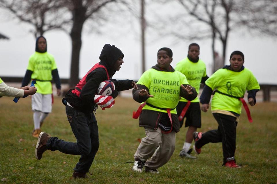 Samuel Kabeya, 11, sprinted down the pitch during a rugby tournament on Saturday at Joe Moakley Park in South Boston.