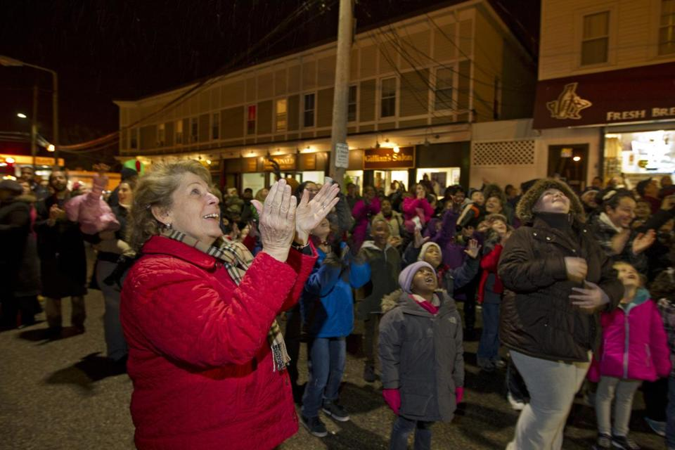 Angela Menino, filling in for her recuperating husband, Mayor Thomas M. Menino, cheered the arrival of Santa Claus as the holiday trolley tour came to Readville on Friday night.
