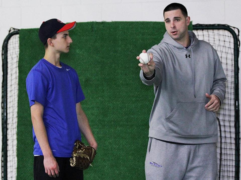 Jeff Allison (right) has found another calling in teaching youth baseball and talking about the perils of drug abuse.