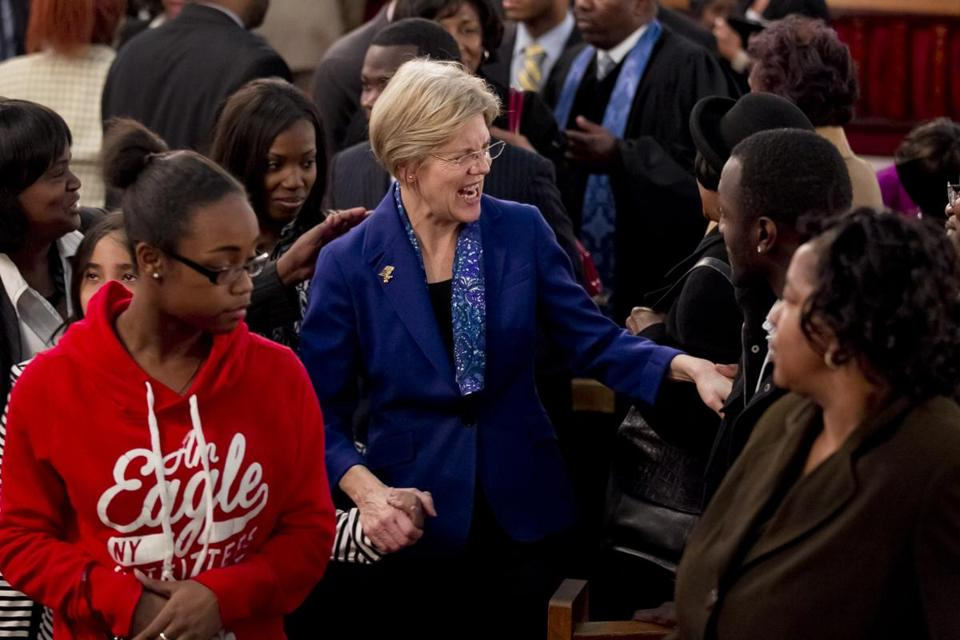 FILE -- Elizabeth Warren shook hands with church goer in Dorchester Sunday.