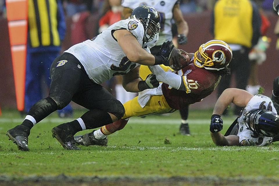 Redskins QB Robert Griffin III hurt his knee on this tackle by the Ravens' Haloti Ngata, but the injury isn't serious.