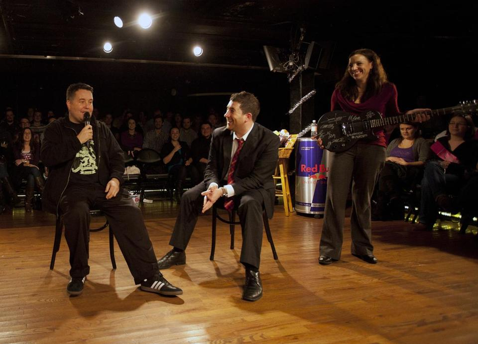 Ken Casey of the Dropkick Murphys (left) auctioned off a guitar signed by band members on Friday during Improv Asylum's 24-hour comedy marathon to benefit Globe Santa.