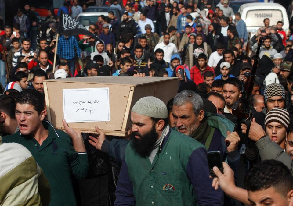 Fighting between pro- and anti-Assad gunmen flared in Lebanon as bodies of three Lebanese — who were killed after crossing into Syria to fight in the civil war — were brought back home for burial.