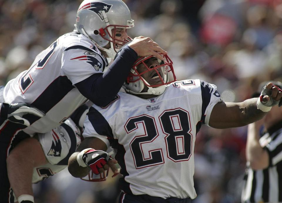 Tom Brady jumped over teammate Matt Light to celebrate Corey Dillon's 15 yard touchdown run during the first quarter.