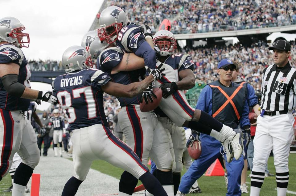 Teammates lofted receiver David Patten after he caught a touchdown pass from Tom Brady in the second quarter.
