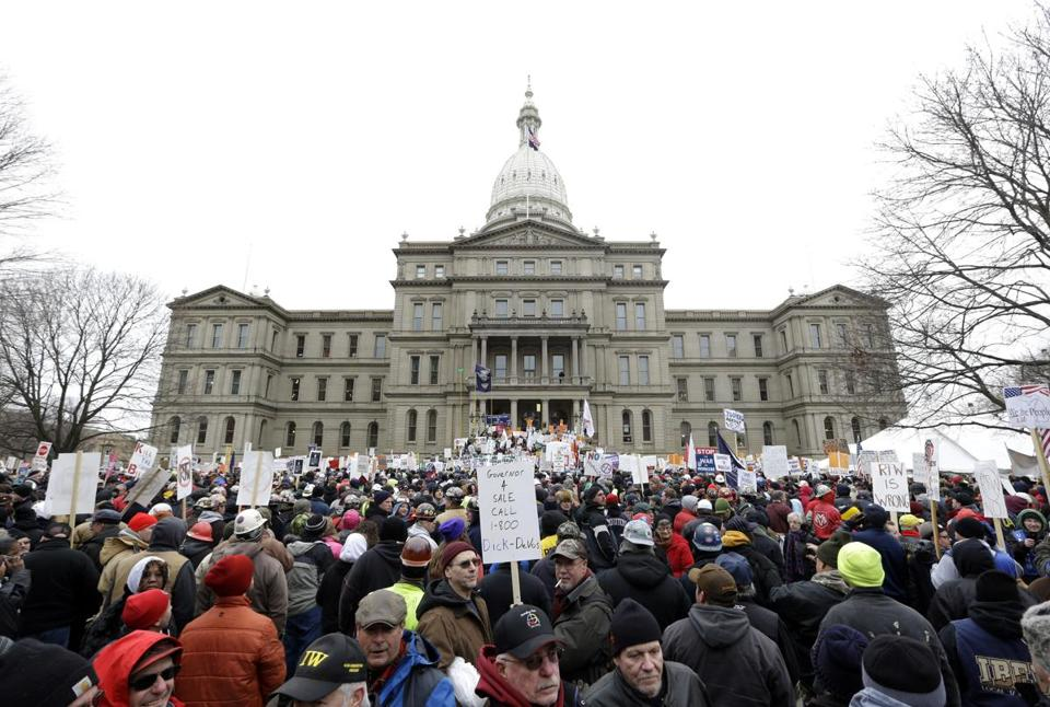 Protesters gathered for a rally at the State Capitol in Lansing, Mich., on Tuesday.