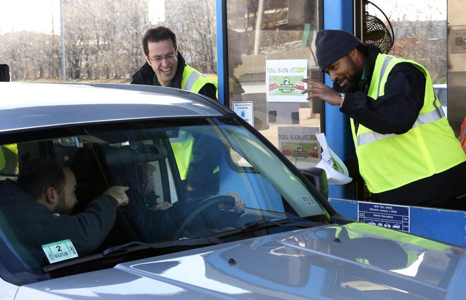 Jared Fogle (left) and Jerod Mayo paying the tolls for commuters on the Mass. Pike on Tuesday.