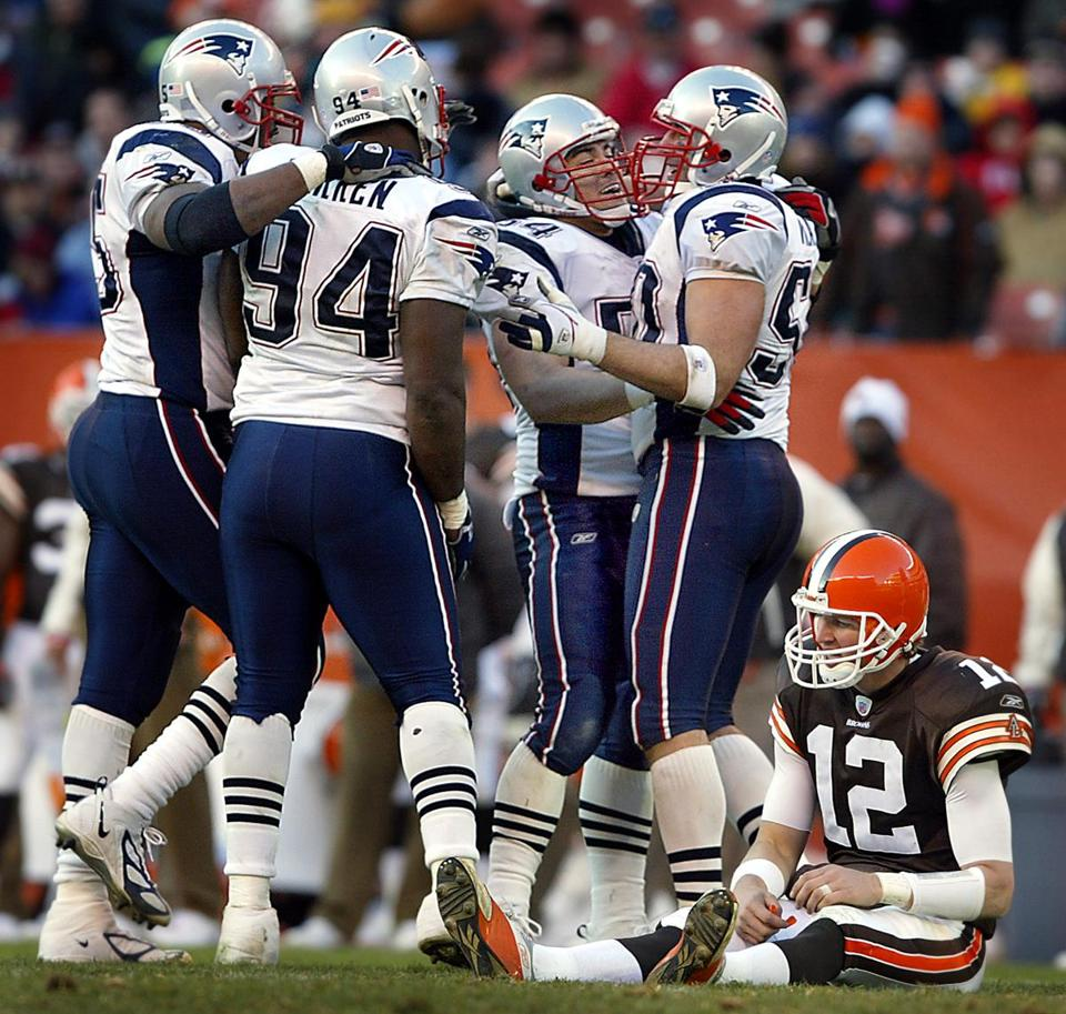 Patriots teammates congratulated Mike Vrabel (right) after he sacked Browns quarterback Luke McCown in the third quarter.