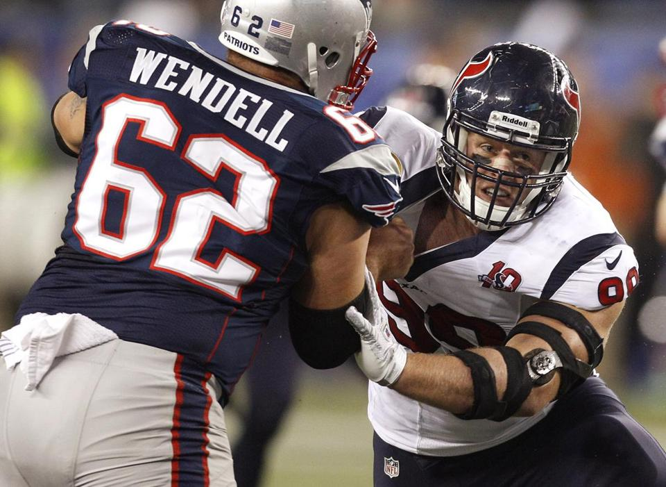 Patriots center Ryan Wendell helped fend off Texans defensive end J.J. Watt.