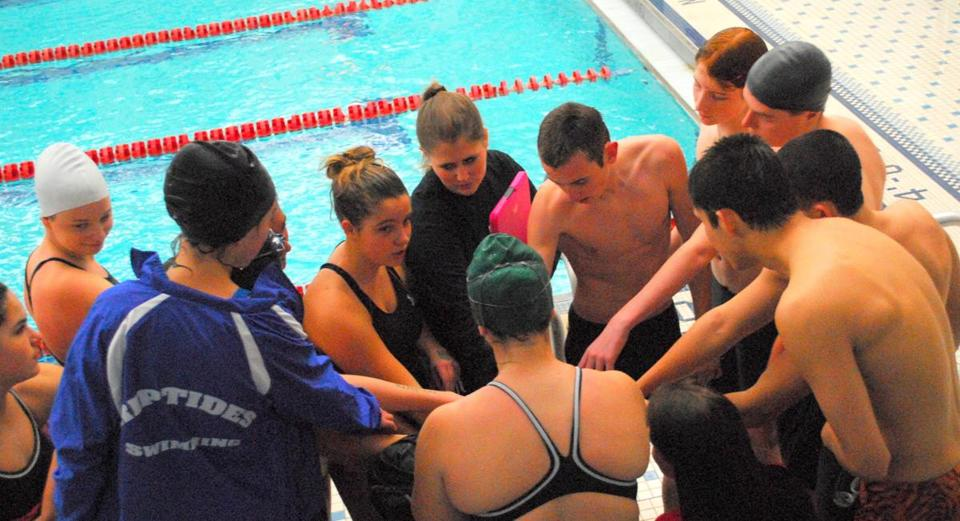 With coach Carly Suzan in the middle, Old Rochester Regional High School's newly formed swim team prepared for its first competitive event, held at Seekonk High School.