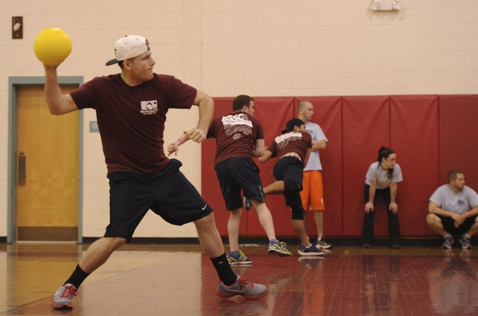 Jason Tilley takes aim during a coed dodgeball game held by the Boston Ski and Sports Club at Watertown Middle School.