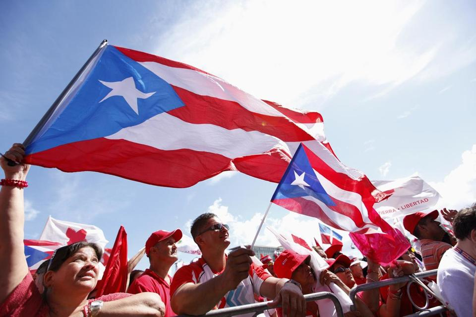 Followers of Puerto Rico's Popular Democratic Party, which favors the current political status, waved the island's flag during a rally in November in San Juan.