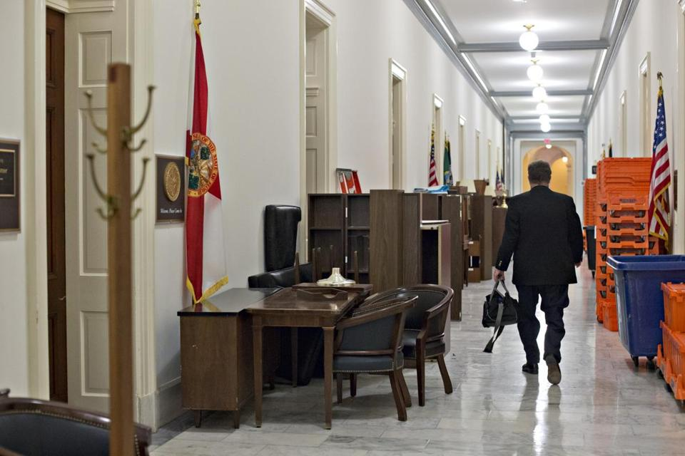 As the 112th Congress approaches its end and lawmakers come and go from elected office, furniture from Congressional workrooms is shuffled in the hallway of the Cannon House Office Building in Washington Wednesday evening.