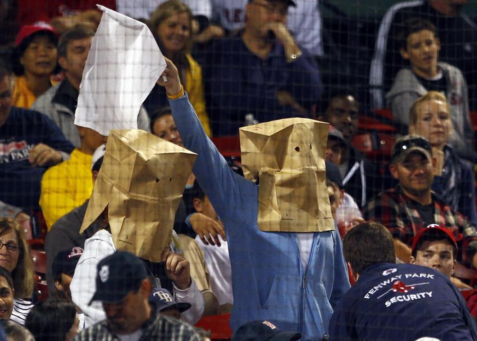 You can wear a bag, but cursing at a sports event is illegal.
