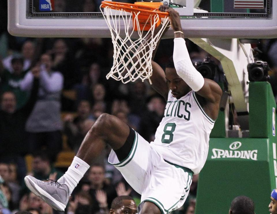 It's look out below as Celtics forward Jeff Green throws down an alley-oop dunk from Rajon Rondo during the fourth quarter.