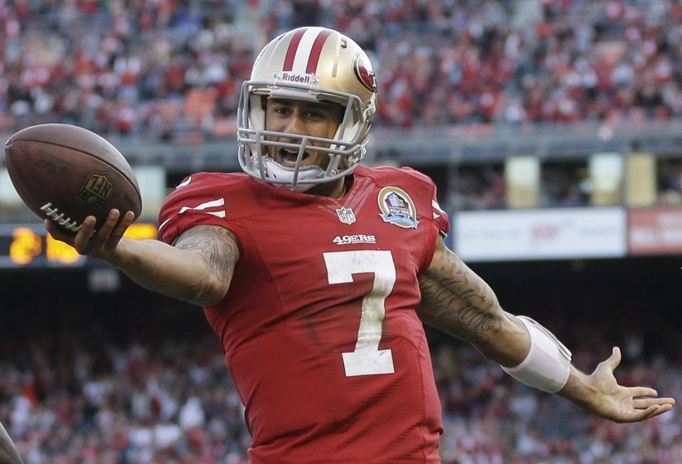 Colin Kaepernick is lanky and a very good athlete. He's a dual threat throwing and running for the 9-3-1 49ers.