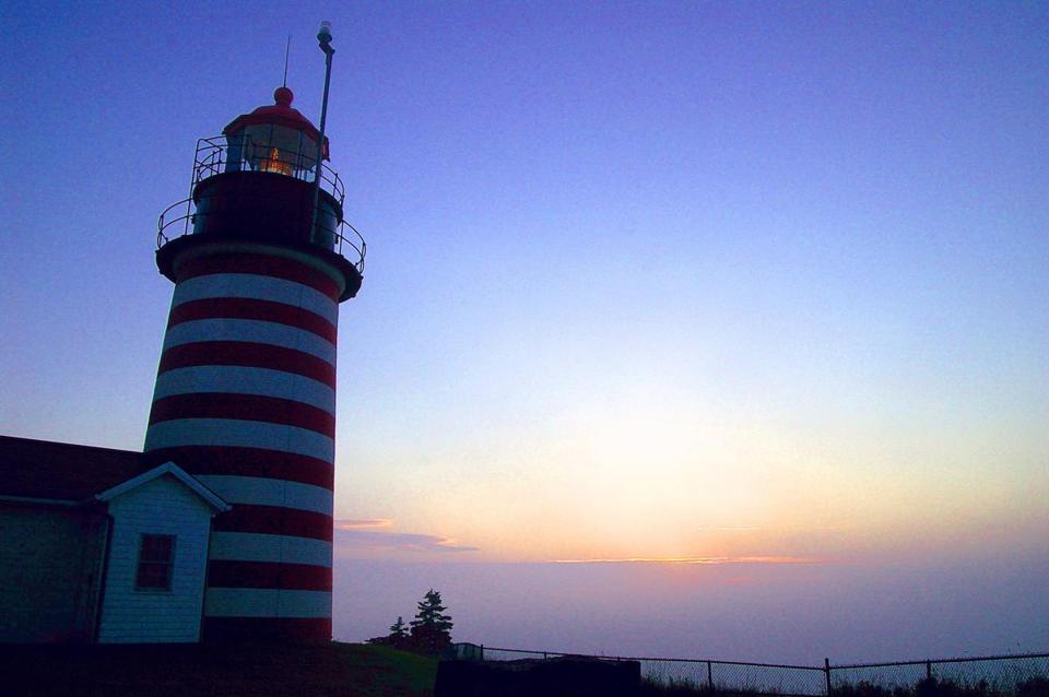 Sky brightens in minutes before dawn at West Quoddy Head Light in Lubec, Maine.