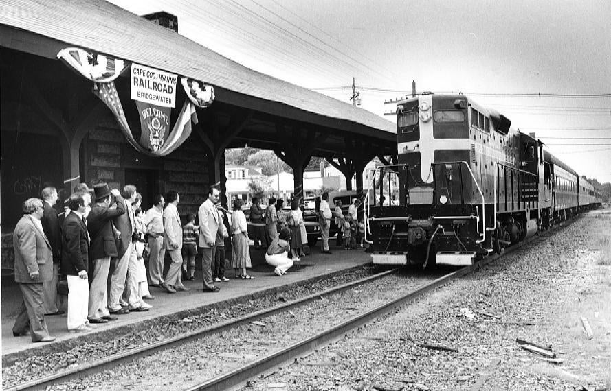 Riders await the arrival of the train to Cape Cod at the Bridgewater depot. June 29, 1984