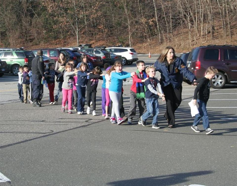 Police told children to close their eyes so that they would not see blood and broken glass as they were led from the Sandy Hook Elementary School after a gunman opened fire Friday.