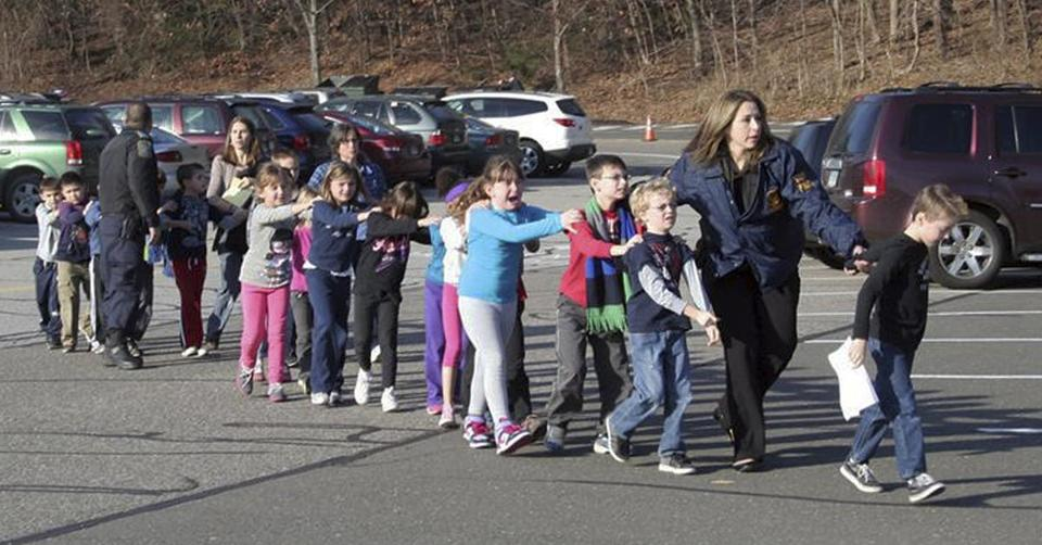 Connecticut State Police led children from the Sandy Hook Elementary School in Newtown, Conn., following a reported shooting on Friday.