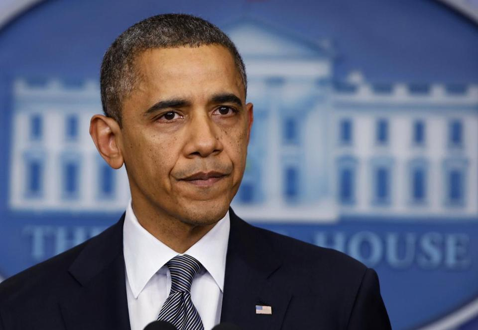 An emotional President Obama paused while speaking about the shooting at Sandy Hook Elementary School in Newtown, Conn.