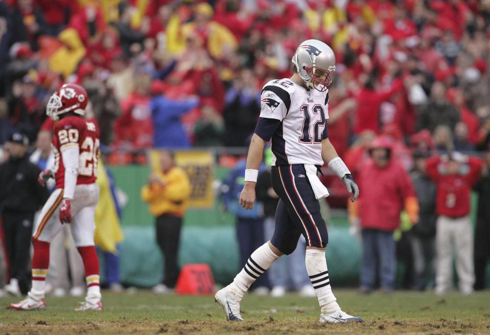Tom Brady walked off the field after throwing his fourth interception against the Chiefs.