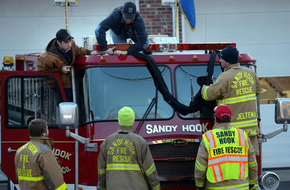 Sandy Hook firefighters hung bunting on their firetruck in Newtown, Conn.