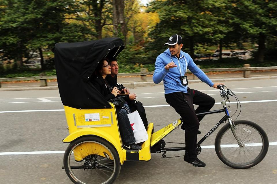Tourists rode a pedicab in Central Park. Most pedicabs now charge by block, per passenger, but that will change.