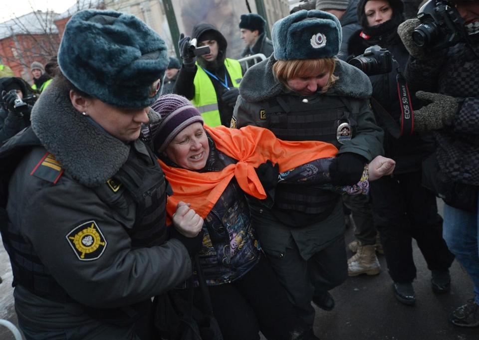 Russian police arrested an activist during an unauthorized protest against Vladimir Putin's policies Saturday.