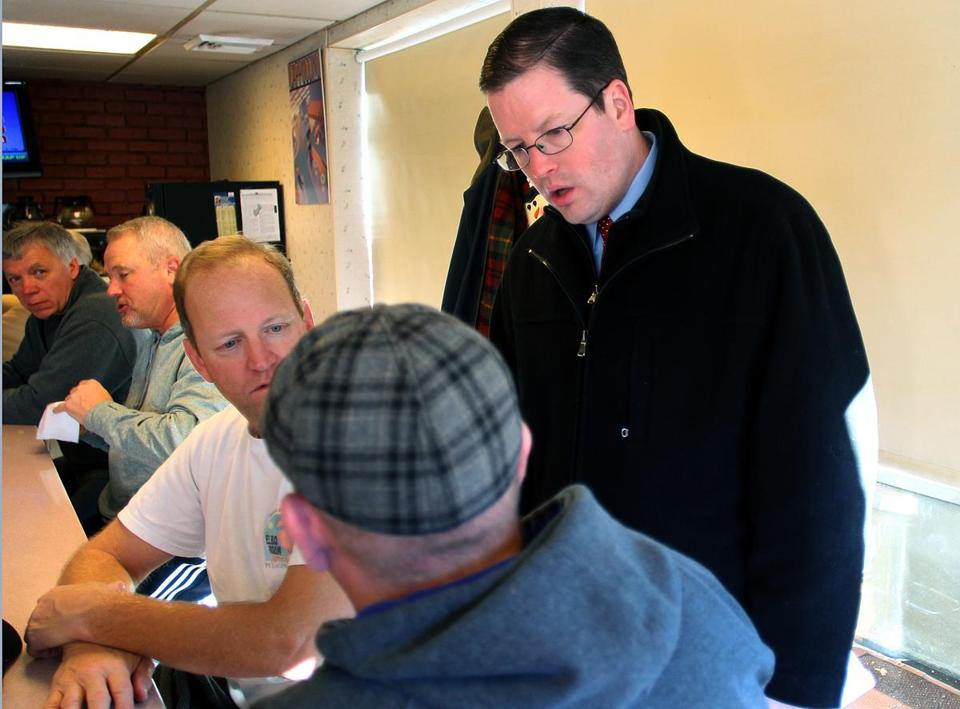 Mike Healy discussed his City Council bid with patrons at the Donut King in Quincy on a recent Saturday.