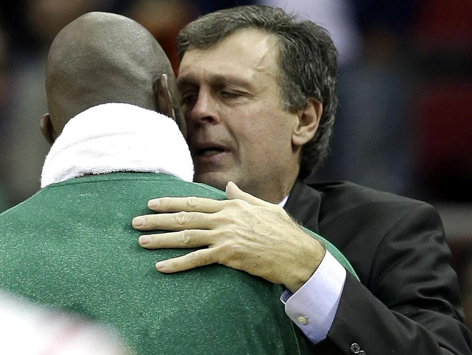 Rockets coach Kevin McHale and Kevin Garnett embrace. McHale recently lost his daughter to lupus.