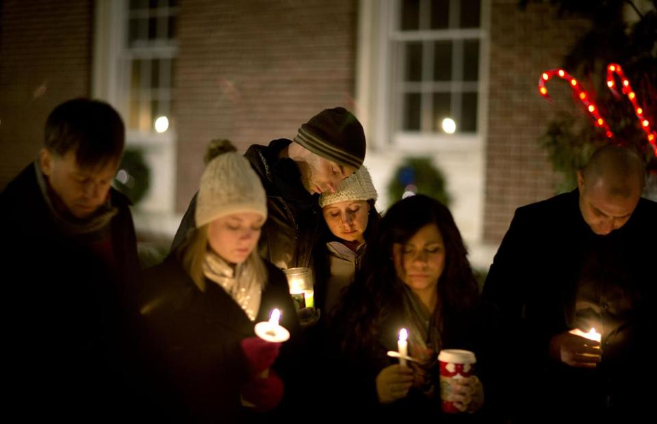 Mourners attended a vigil in Newtown, Conn., Saturday.