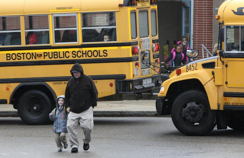 Students ended their school day at the Beethoven School in the West Roxbury Monday. Many schools decided to lock front doors that were previously left open.