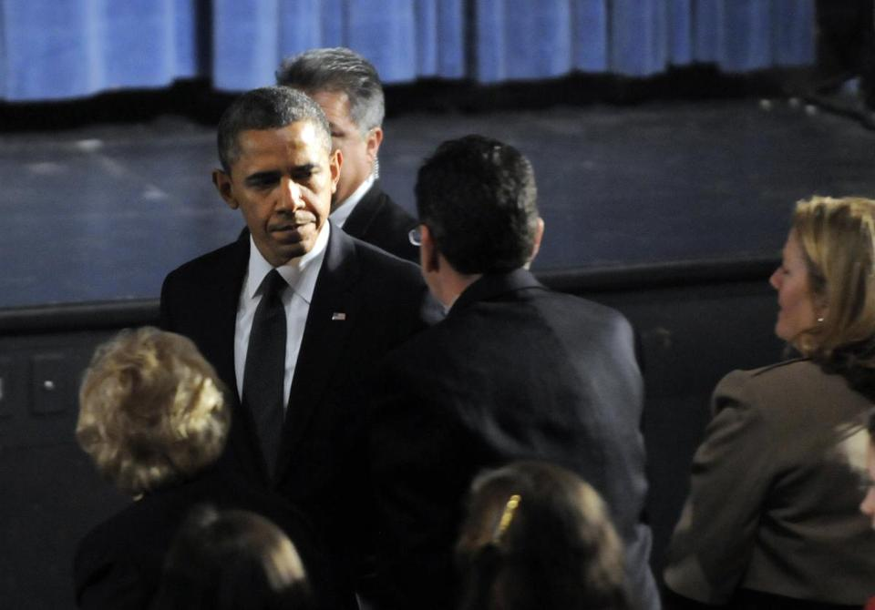 President Obama greeted Governor Dannel Malloy of Connecticut at the start of an interfaith vigil for victims.
