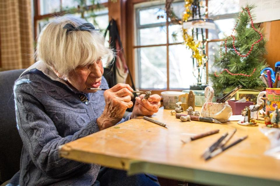 Annette Petersen, 93, works on a Wee Forest Folk piece in her Carlisle studio, where the family-run enterprise specializes in crafting tiny mice as part of its line of collectible figurines.