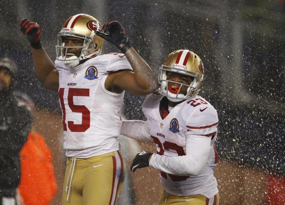 49ers receiver Michael Crabtree, left, scored the winning touchdown for San Francisco.