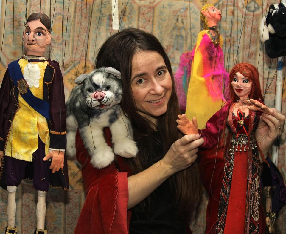 Charlotte Anne Dore and her puppets.