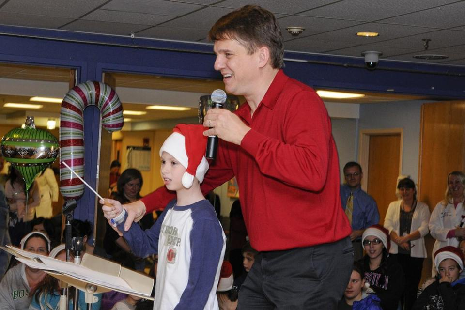 Keith Lockhart conducts with Bradley, a patient at the hospital.