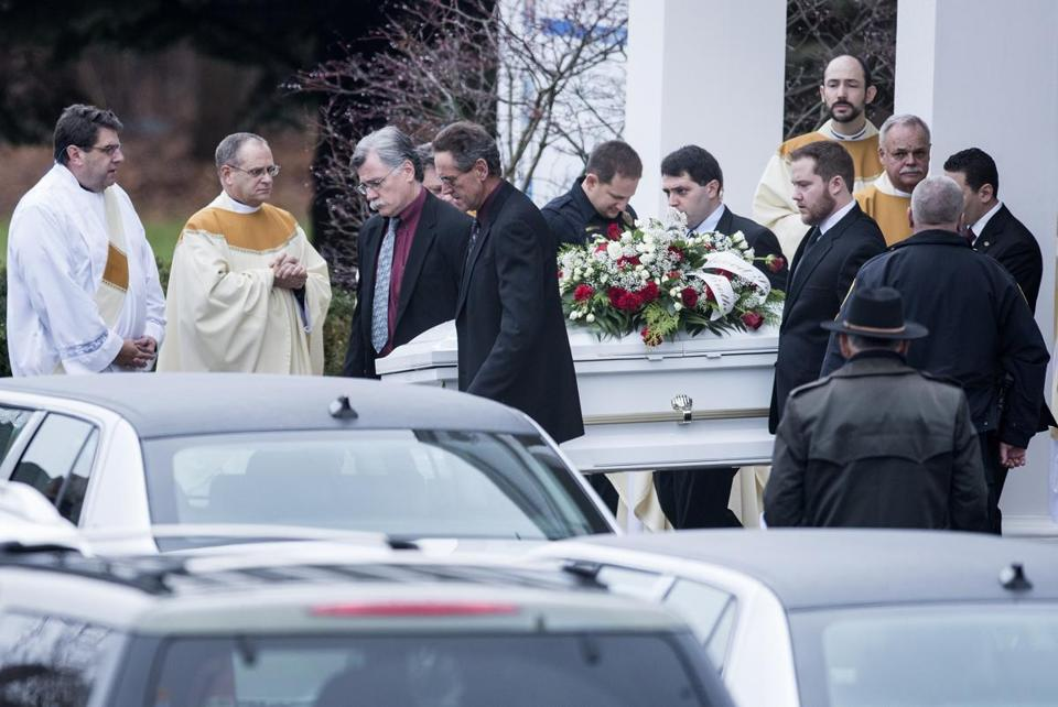 The casket of six-year-old James Mattioli was carried from St. Rose of Lima Roman Catholic Church in Newtown, Conn., on Tuesday.