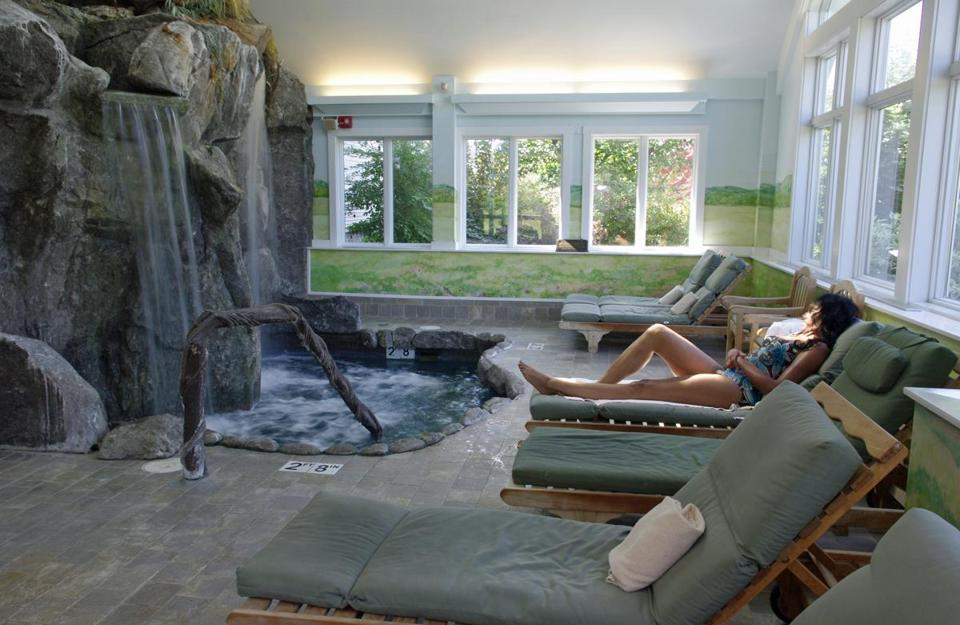 You can relax in a lounge chair or in the 97-degree water that cascades into a pool in the aqua solarium at the Spa at Snowflake in Vermont.