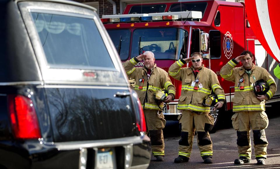 Firefighters saluted as a hearse passed for the funeral procession to the burial of 7-year-old Sandy Hook Elementary School shooting victim Daniel Gerard Barden on Wednesday.