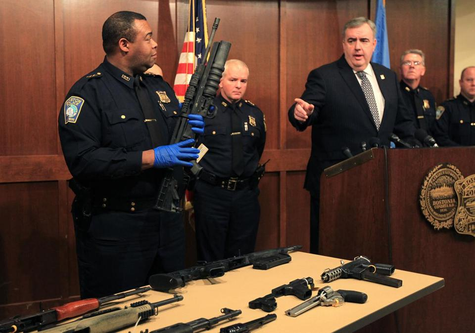 "Boston police Commissioner Edward F. Davis pointed to an assault rifle similar to the one used in the Newtown, Conn. shootings, held by Deputy Superintendent William Gross. Davis said the weapons ""have no place in our communities."""