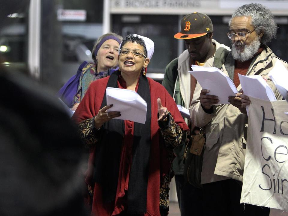 Beverly Scott, the new MBTA general manager, joined carolers at Forest Hills Station Wednesday.