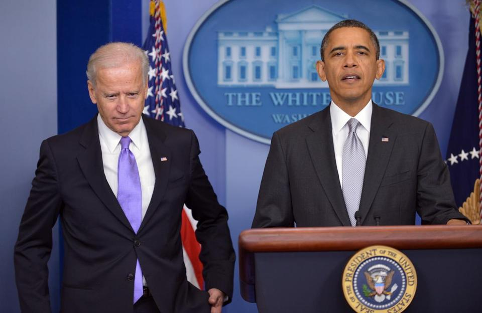 President Obama spoke as Vice President Biden looked on at a press conference at the White House on Wednesday.