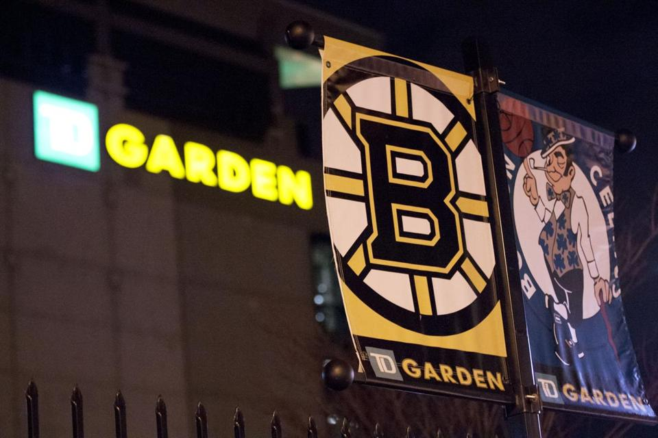 The banners for the Boston Bruins and Boston Celtics hang together on a post outside of the TD Garden.