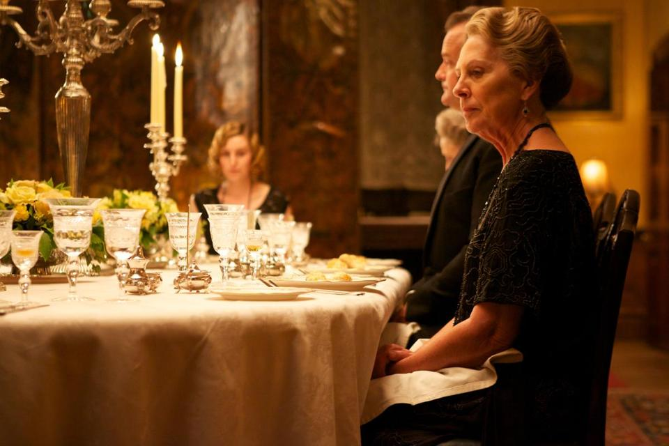 "Penelope Wilton (foreground) sat down to a formal dinner on ""Downton Abbey."" While the actors appear to be cooking and eating on the show, most of the food is not edible."