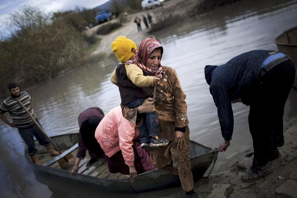Syrian refugees crossed into Turkey by the Orontes river, near the village of Hacipasa, Turkey, on Dec. 8.