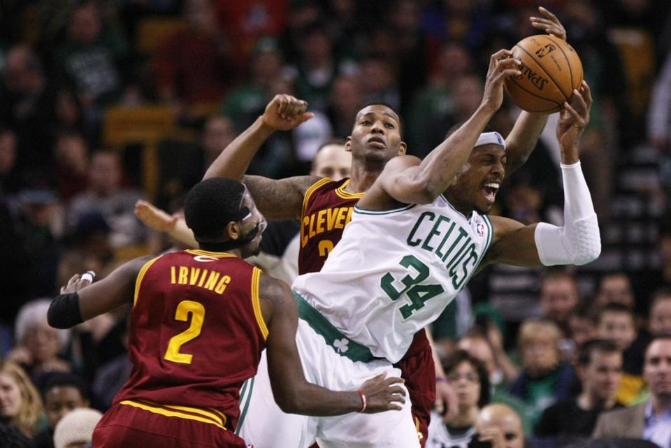 Celtics forward Paul Pierce broke through Cavaliers forward Alonzo Gee and guard Kyrie Irving in the third quarter. Pierce became the oldest Celtic to score 40 points in a regulation game.